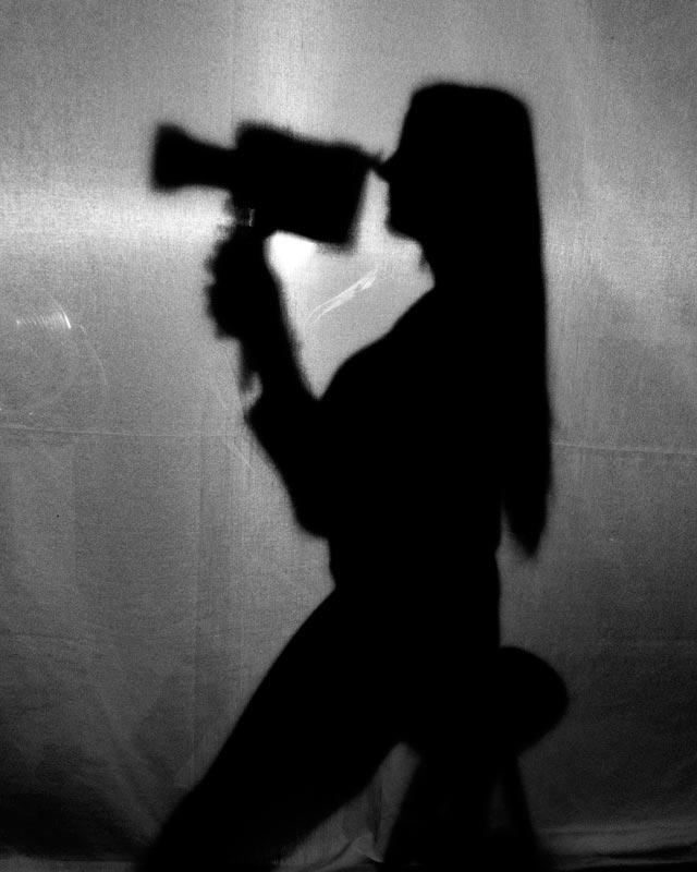 Siluetas con cámara de cine super 8
